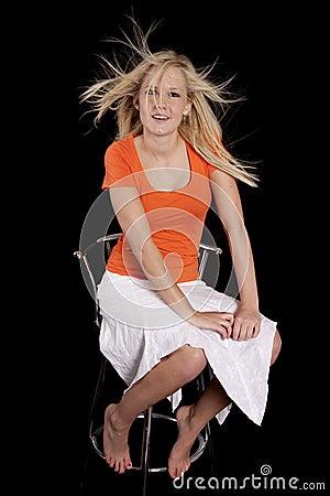Woman orange chair crazy hair