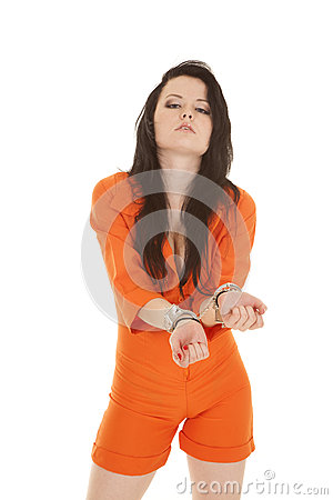 Woman orange prison handcuffs front hands