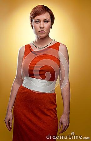 Woman in orange retro dress