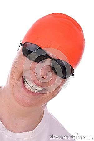 Woman with an orange swim cap