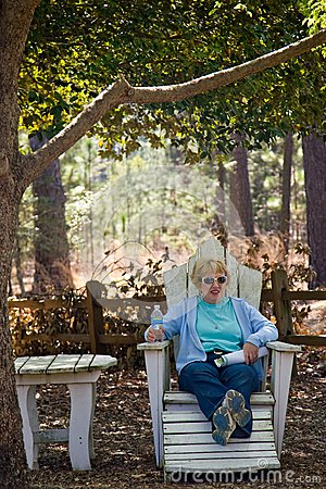 Woman on outdoor furniture
