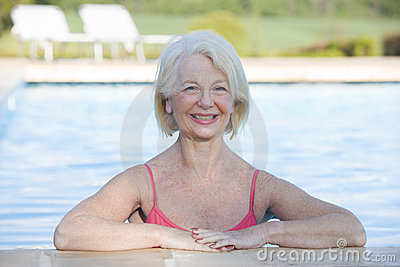 Woman in outdoor pool smiling