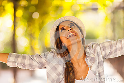 Woman outdoors arms outstretched