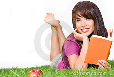 Woman outdoors reading book