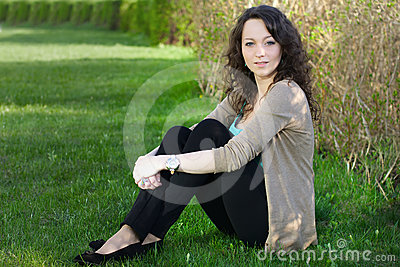 Woman outdoors sitting