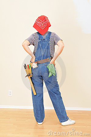 Woman in Overalls and Toolbelt