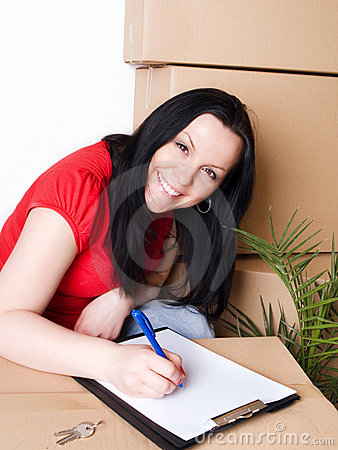 Woman with package signs delivery paper