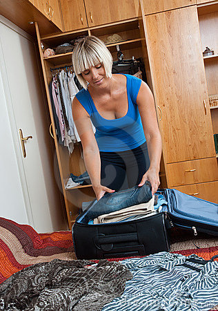 Woman packing clothes
