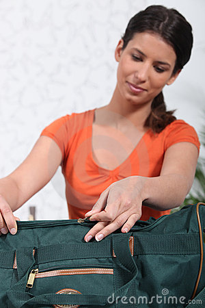 Woman packing green bag
