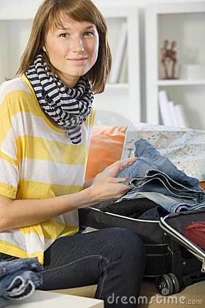Woman packing her luggage