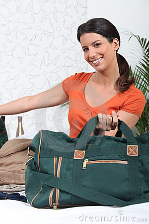 Woman packing her travel bag