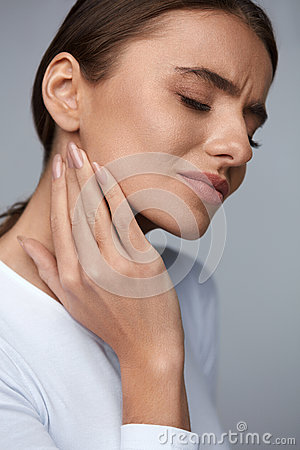 Woman In Pain. Beautiful Girl Feeling Toothache, Jaw, Neck Pain Stock Photo