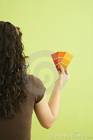 Woman with paint swatches.