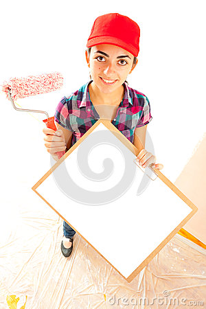 Woman painter with clipboard and paint brush