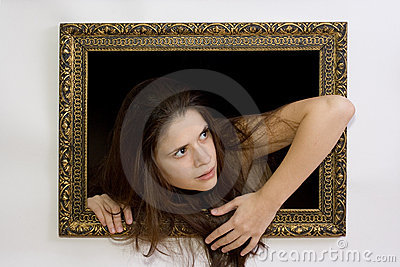 Woman in a painting frame