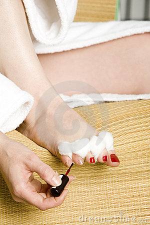 Woman painting her toe nails