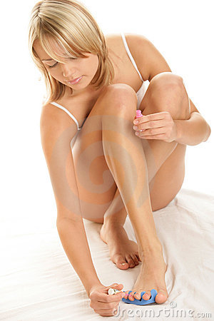 Woman painting her toenails