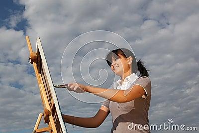 Woman painting landscape