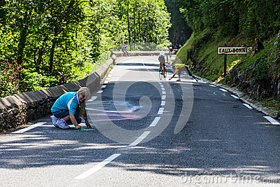 Woman Painting the Road to Col d Aubisque Editorial Photo