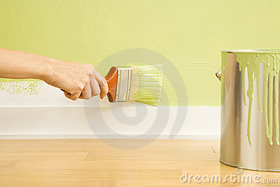 Woman painting trim.