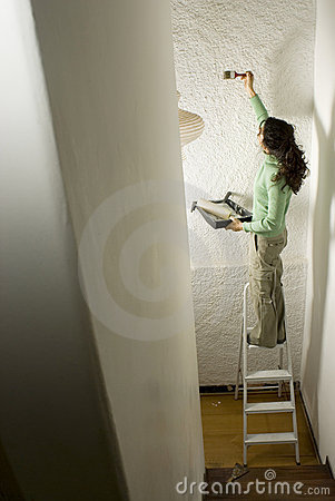 Woman Painting a Wall - Vertical
