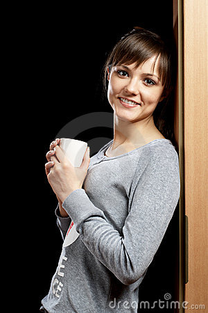 Woman in pajamas leaning