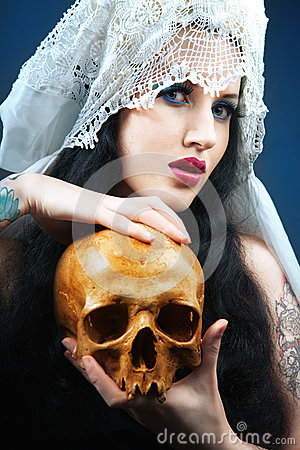 Woman with a pale face and skull.
