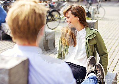 Woman on a Park Bench Together with Boyfriend