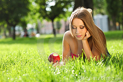 Woman in the park with book