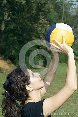 Woman in Park Playing Volleyball - Vertical