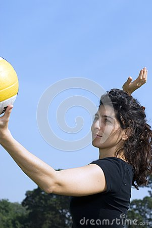 Woman in Park Spiking Volleyball - Vertical