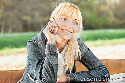 Woman at park taking a phone call