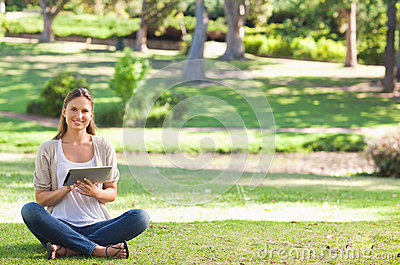 Woman in the park using her tablet computer