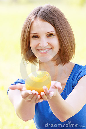 Woman passing orange