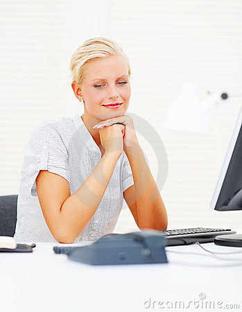 Woman patiently waiting for call at the desk