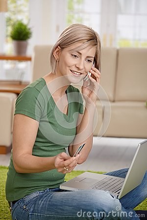 Woman paying bills from home