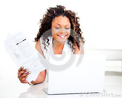 Woman paying bills online