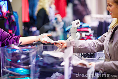 Woman paying cashier for clothing