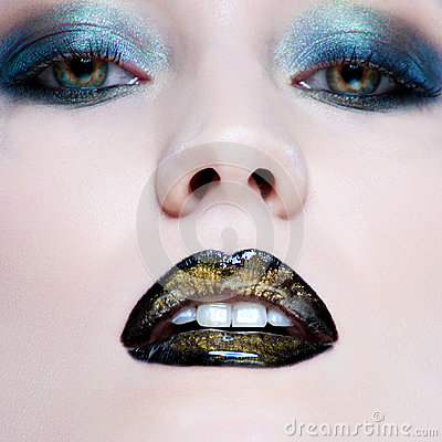Woman with pearl glamour make-up and black lips