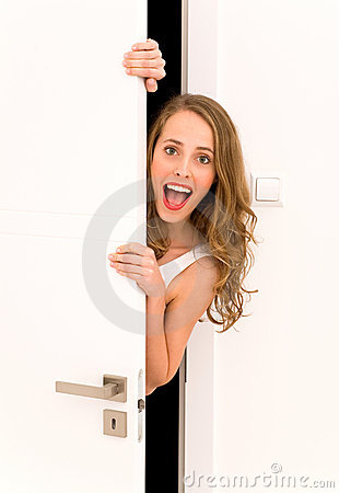 Woman peeking through door