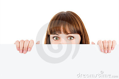 Woman peeking over blank billboard