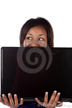 Woman peeking over laptop