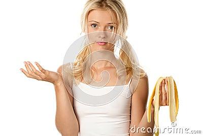 Woman with peel of banana