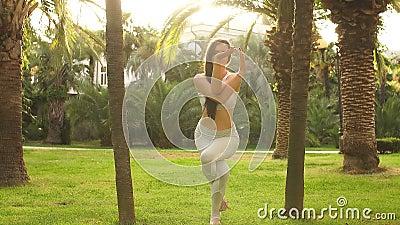 flexible professional female dancer jumping in energetic