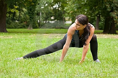 Woman performs stretching before