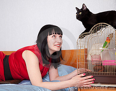 Woman with  pets in home