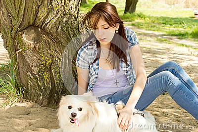 Woman petting her cute little dog