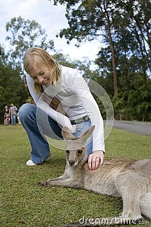 Woman petting kangaroo at Australia Zoo