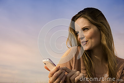Happy young woman with mobile
