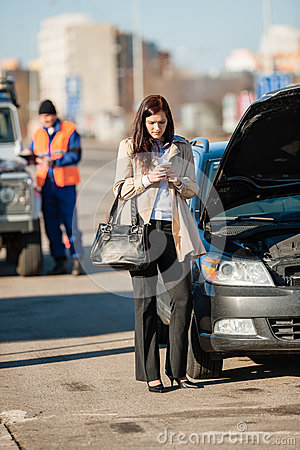 Woman on the phone after car crash